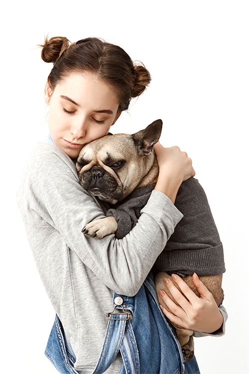 Young girl holding dog