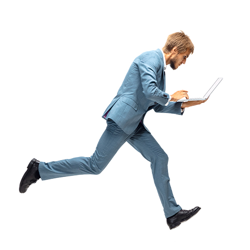 Man in suit rushing with laptop